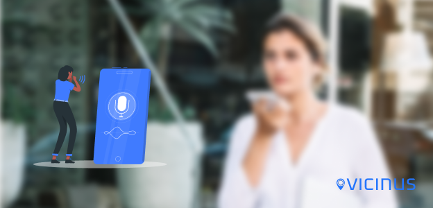 How to get your business voice search optimized blog image. Background shows a lady speaking into her phone. In the foreground is a graphic of a woman speaking into a mobile device