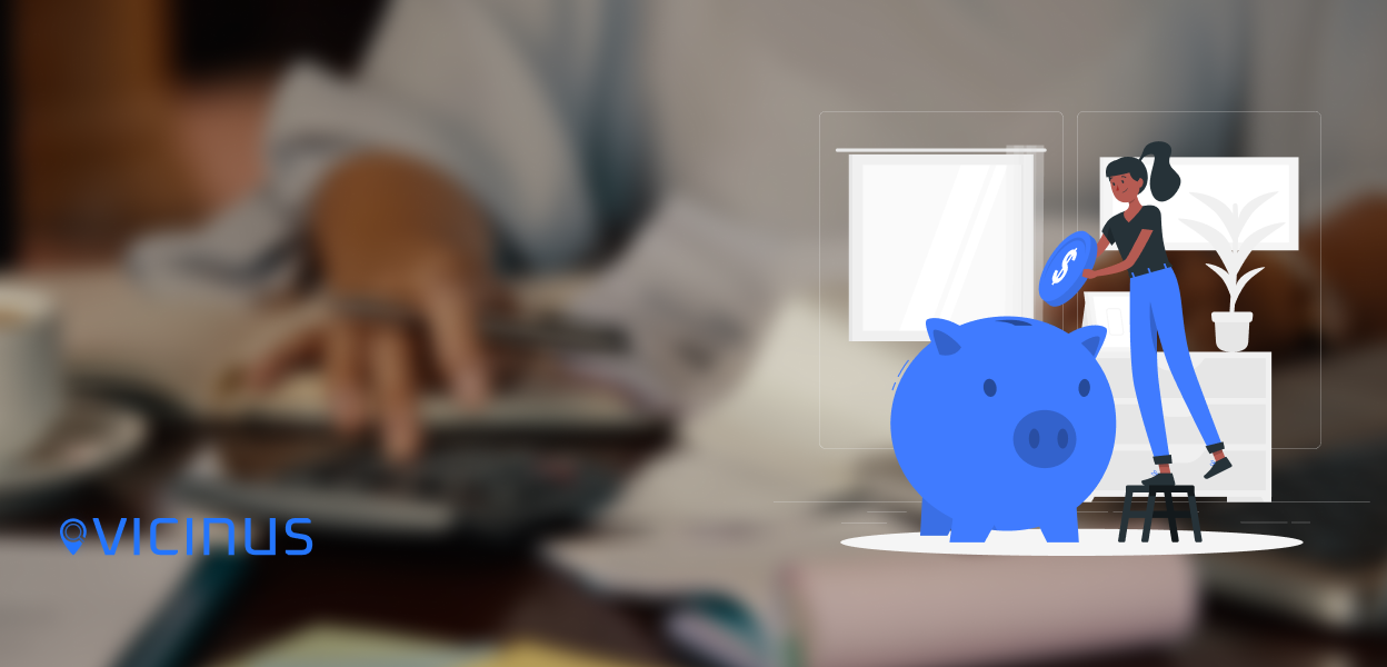 How to spend your marketing budget for the end of 2020 blog image. Background shows someone doing sums on a calculator. In the foreground is a graphic of of a woman putting money into a piggy bank to represent marketing budgeting