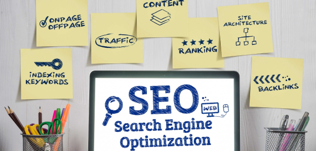 Local Search Engine Marketing blog. Photo shows laptop with SEO on screen and post it notes on the wall surrounding with SEO terms.
